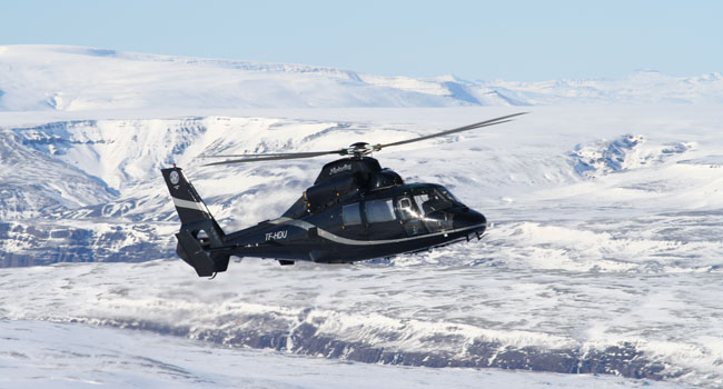 Helicopter flying over Icelandic landscape