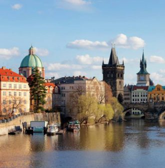 Sunlit Prague old town by the river