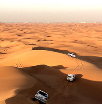 Group incentive activity: 4x4s driving through the desert in the UAE
