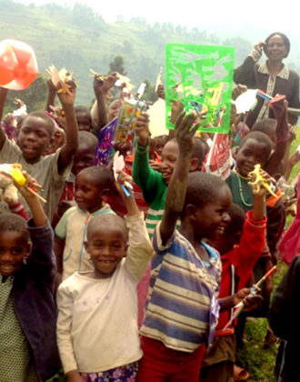 pack for a purpose - csr - children holding new school supplies