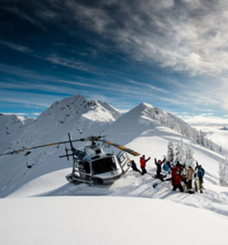 Ski Incentives - skiers getting out of a helicopter on top of a mountain