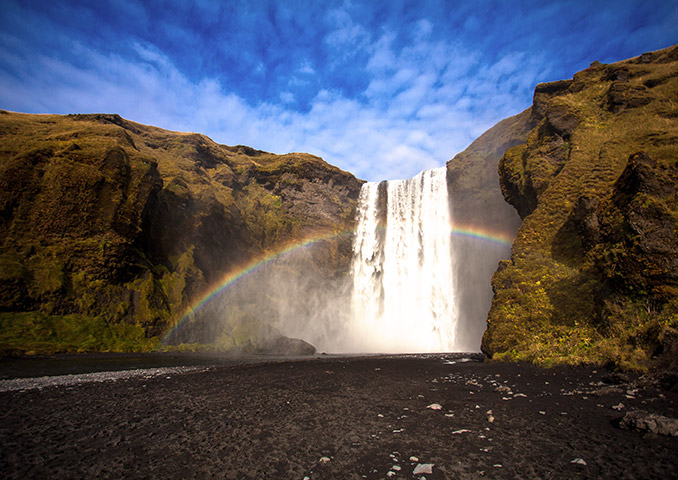 Skogafoss waterfall with a rainbow, Iceland