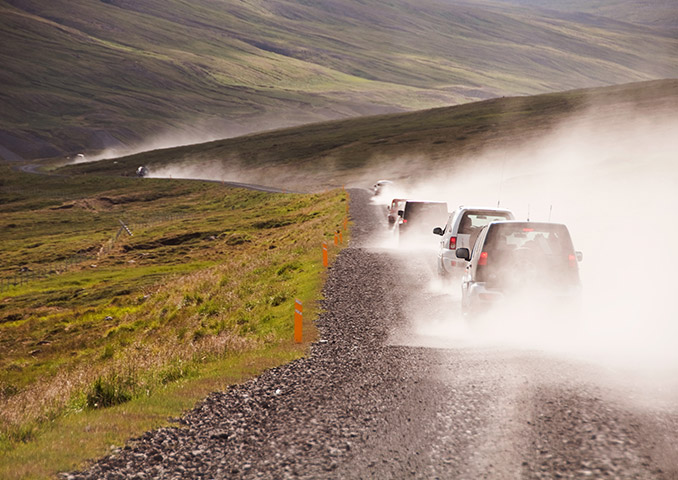 4x4s driving along a gravel road in Iceland