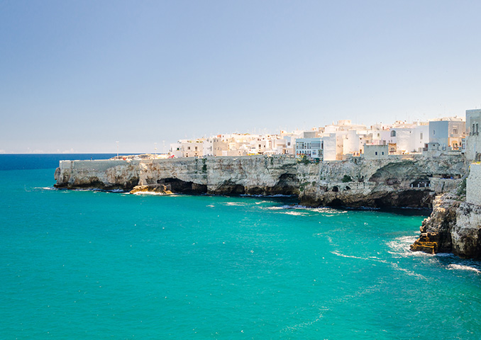 Azure blue seas and clifftop houses in Puglia