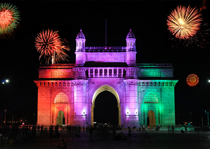 Gateway of India monument lit up at night