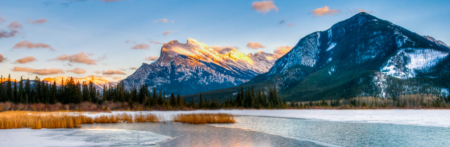 Canadian landscape image of a flowing river with mountains in the distance