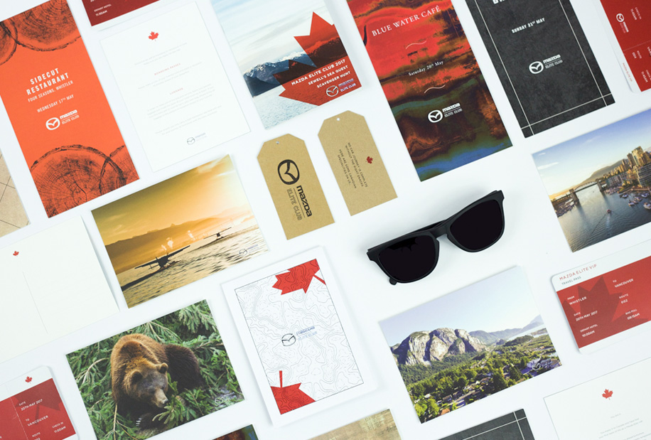 Mazda Elite comms flat lay of teasers, menus and onsite gifts