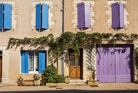 Colourful painted doors and shutters in Provence, France