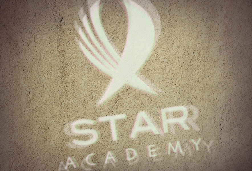 Star Academy logo projected onto a wall