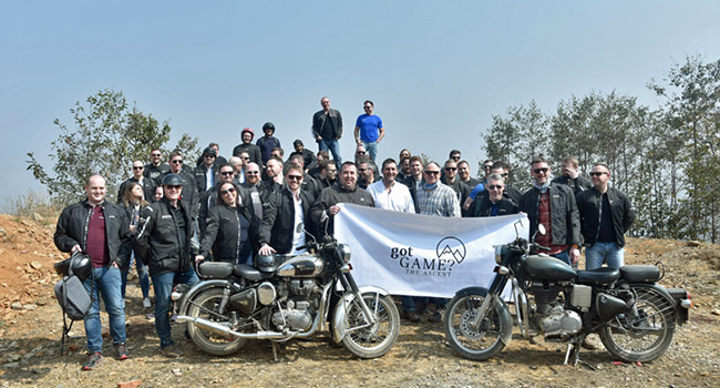 Incentive Programme of the Year: Winners from MINI UK hold their flag aloft at a scenic viewpoint on their Royal Enfield roadtrip