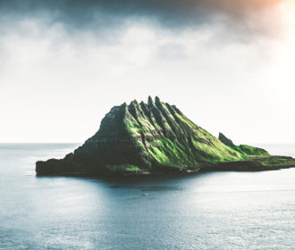 Combat Workplace Stress - image of a volcanic island surrounded by calm ocean