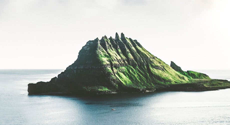 Combat Workplace Stress - An uninhabited volcanic island surrounded by calm ocean