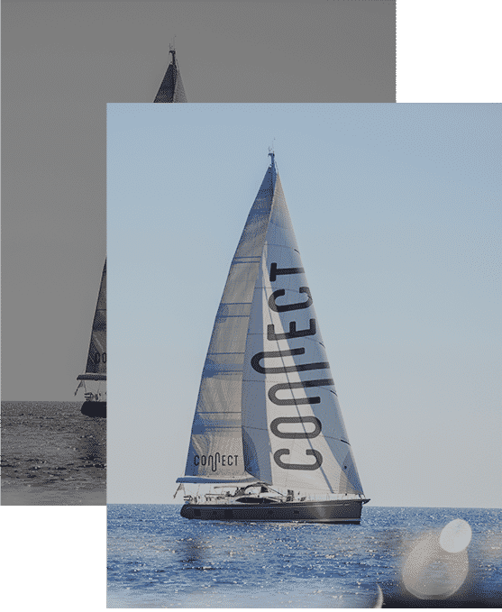 Communications - yacht with a branded sail