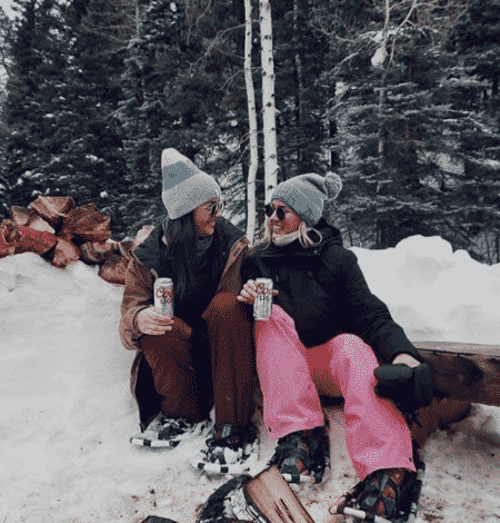 Expedition Coors Light - influencers enjoying a Coors Light in the snow at Dunton Hot Springs